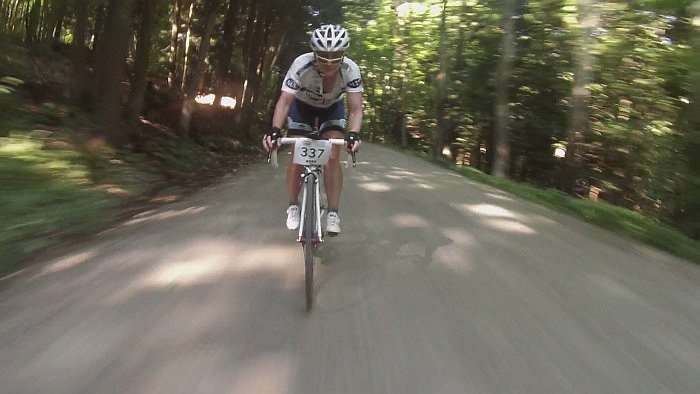 Amy on my wheel as I bombed a descent... she's on 25mm tires. Impressive skills.
