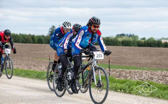 Photo by TMB Images. Tandem with the hammer down, Charlie at left struggling.